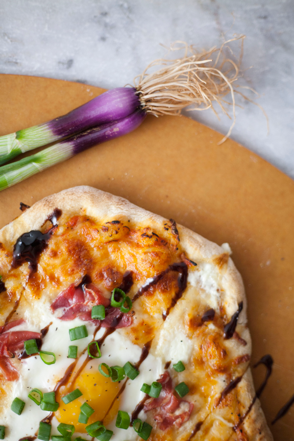 handmade pizza with spring onions, prosciutto, balsamic, and egg // a thousand threads