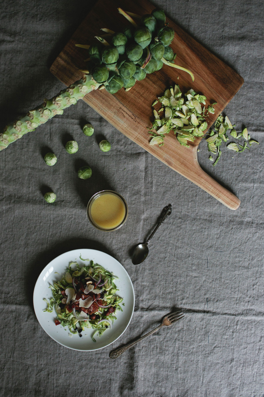 shaved brussels sprout salad with currants and bacon vinaigrette // a thousand threads
